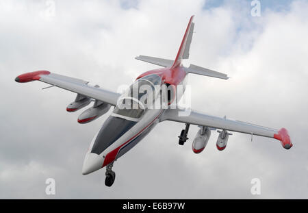 dynamic shot of a aircraft and cloudy sky - Stock Photo