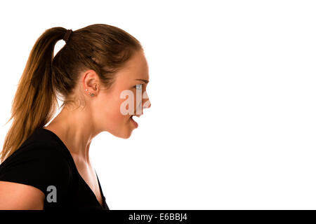 Angry young woman screams into a copy space isolated - Stock Photo