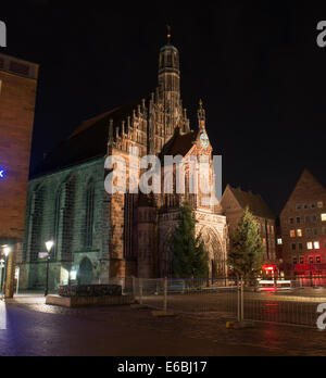 View of the Frauenkirche (Our Lady's Church) am Hauptmarkt at night in Nuremberg, Germany - Stock Photo
