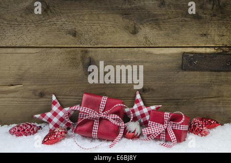 Presents for christmas in red white checkered color on wooden old country style background. - Stock Photo