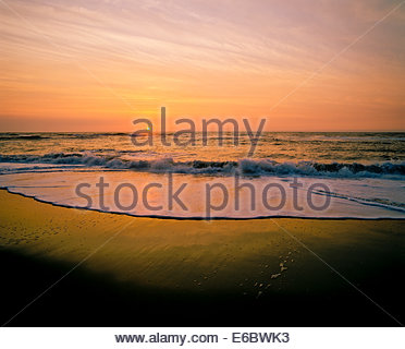 Sunrise over the Atlantic Ocean at Cape Hatteras National Seashore on the Outer Banks of North Carolina USA - Stock Photo