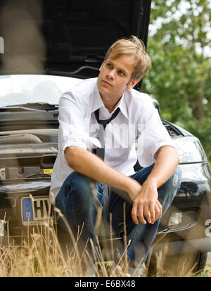 young man,waiting,vehicle breakdown,car driver - Stock Photo