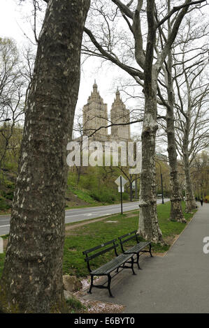 Road, walkway and public seating in Central Park, New York, with San Remo apartment building in background. Manhattan, - Stock Photo