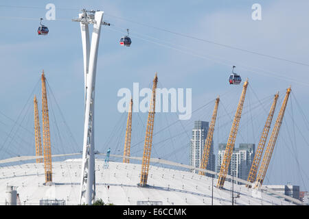 A cable car system known as The Emirates Air Line after it's sponsor, spans the river Thames next to the O2 Arena, - Stock Photo