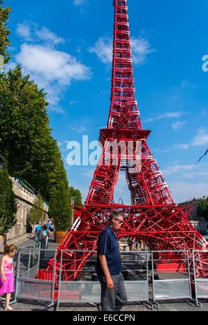 Paris, France, Tourists enjoying Public Events, 'Paris Plages', Urban Beach, Eiffel Tower Installation on Street, - Stock Photo