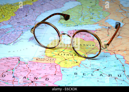 Glasses on a map of europe - Latvia - Stock Photo