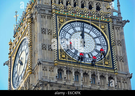 Big Ben Elizabeth Tower clock face being cleaned with hands set to wrong time of 12 noon or midnight - Stock Photo
