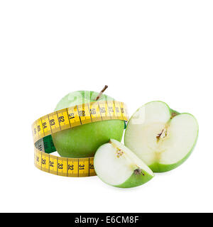 Healthy eating and diet concept. Green apples and measuring tape isolated on  white background - Stock Photo