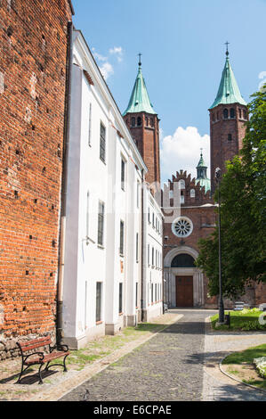 Plock Cathedral with two Gothic towers in old town, Poland - Stock Photo