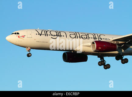 Virgin Atlantic Airways Airbus A330-300 long haul aircraft on final approach at sunset. Close-up of front section in side view.