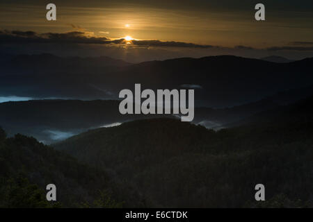 Landscape view of sunrise and mist settled in valleys, Burgui, Spanish Pyrenees in March 2014. - Stock Photo