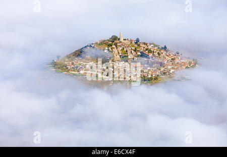 Aerial view of the island of Janitzio surrounded by clouds in Lake Patzcuaro, Michoacan, Mexico. - Stock Photo