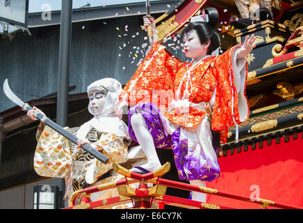 Children participating in a Kabuki performance atop a yatai (float) during Furukawa Festival, Hida-Furukawa, Japan. - Stock Photo