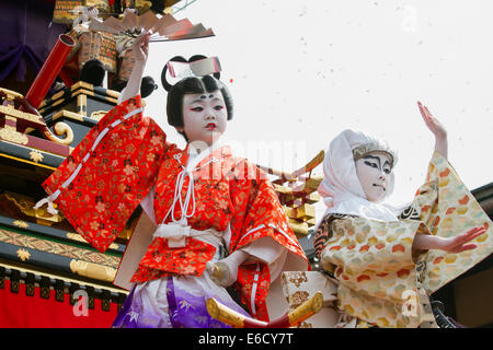 Children in costume in a Kabuki performance on a yatai (festival float) at Furukawa Festival, Hida-Furukawa, Japan. - Stock Photo