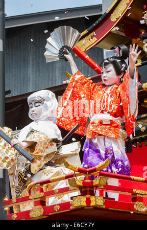 Children participating in a Kabuki performance atop a yatai (festival float) during Furukawa Festival, Hida-Furukawa, - Stock Photo