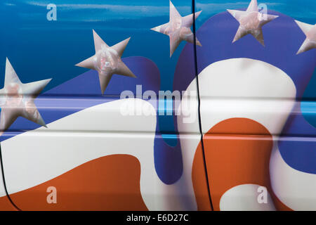 American flag with the Avengers spray painted in the stars on a transporter VW Van - Stock Photo