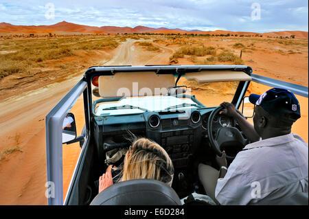 In Safari car on the dunes of the Sossusvlei, Namibia - Stock Photo