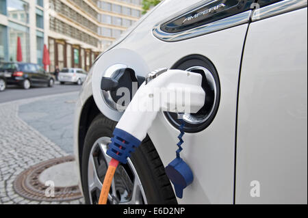 Electric car, Opel Ampera, at a charging station, Berlin, Germany - Stock Photo