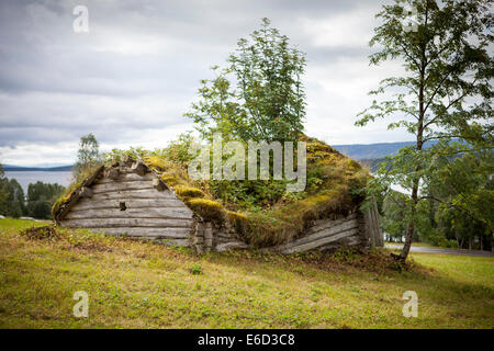 Really old wooden shed in Lapland, Sweden. Grass is growing on the roof. The shed is falling apart and slowly going - Stock Photo