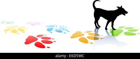 Editable vector illustration of a young dog silhouette and colorful paw prints with space for text - Stock Photo