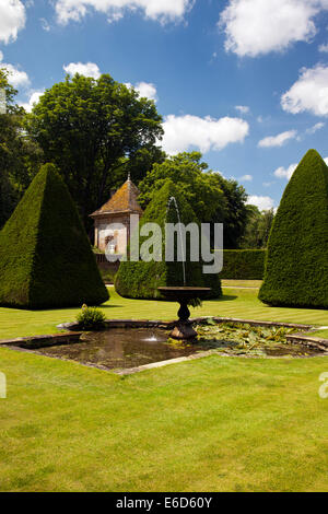Clipped yew trees in the sunken garden of the Great Court at Athelhampton House, Dorset, England, UK - Stock Photo