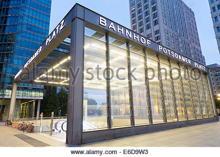 Germany, Berlin, entrance of lighted railway station at Potsdam Square - Stock Photo