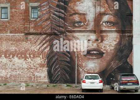 New Zealand, South Island, Christchurch, mural of a female model on a brick wall - Stock Photo