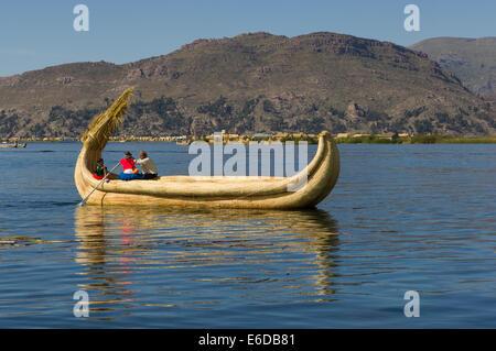 Uros reed boat on Lake Titicaca, near Puno, Peru - Stock Photo