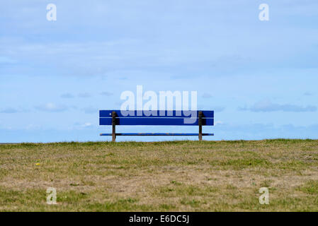 Empty blue wooden bench on seafront in Blackpool, Lancashire, England - Stock Photo