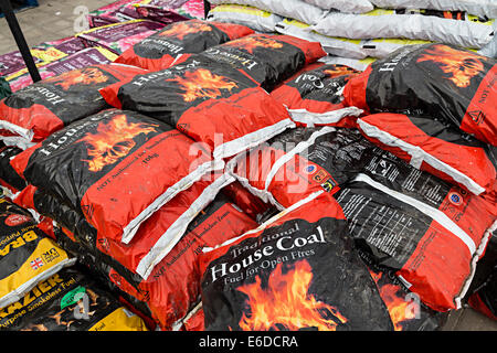 Bags of coal on sale at garden centre, UK - Stock Photo
