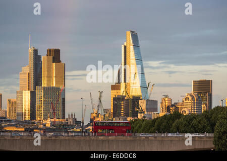 London evening skyline: London bus on Waterloo Bridge, iconic modern buildings including Heron Tower, Tower 42, - Stock Photo