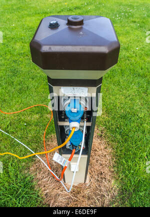 An electricity supply box with connections and cables on a Caravan Club campsite in England, UK. - Stock Photo