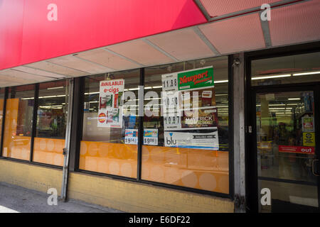 Cigarettes and e-cigs advertised in the window of a Family Dollar store in the Bronx borough of New York - Stock Photo
