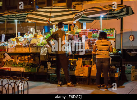 Fruit and vegetable stand in the New York neighborhood of Chelsea on Saturday, August 16, 2014. (© Richard B. Levine) - Stock Photo