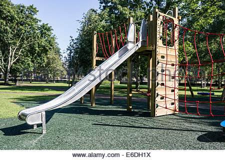 New slide in a children's playground - Stock Photo