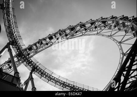 Rollercoaster against the sky in Korakuen near the Tokyo Dome, Tokyo - Stock Photo