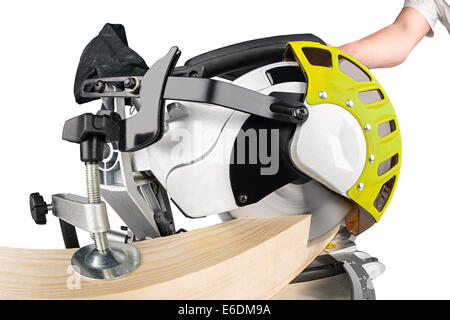 miter saw cutting a wooden beam - Stock Photo