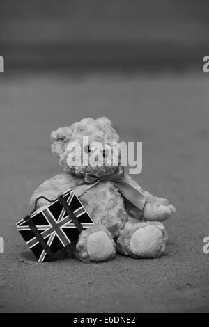 Teddy Bear on the Beach Black and White - Stock Photo