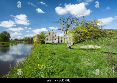 Beside the River Nene and all that remains of the former motte & bailey castle at Fotheringhay in east Northamptonshire, - Stock Photo