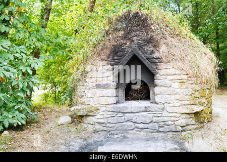 old outdoor stone oven in village de Breca, Briere Regional Natural Park, France - Stock Photo