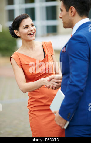 Two business people greeting - Stock Photo