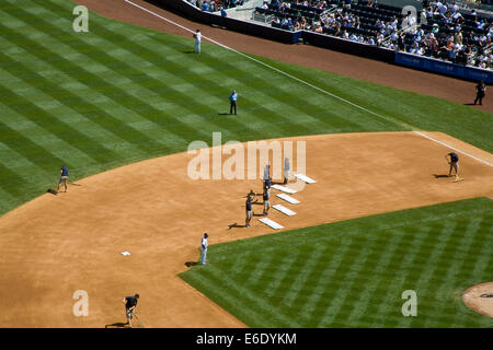 Ground Crew performing to the song 'YMCA' during 7th Inning stretch, Yankee Stadium (New), The Bronx, New York City, - Stock Photo