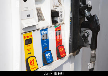 Fuel dispenser at service station gas showing price per litre - Stock Photo