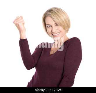 Isolated successful and happy older woman in pullover making fist gesture. - Stock Photo