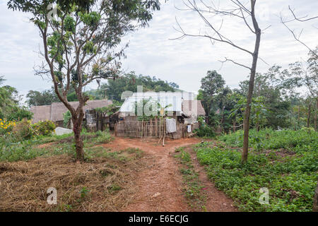 Typical Lahu wooden village houses with corrugated iron roofs, Chiang Khong in Chiang Rai province, northern Thailand - Stock Photo