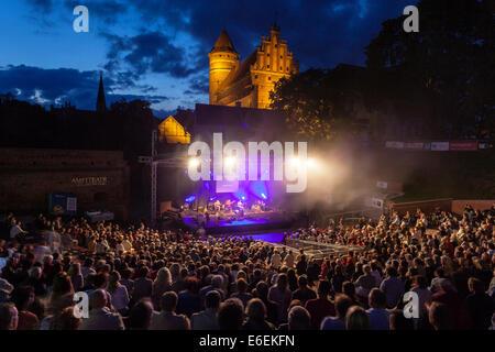 Gothic castle in Olsztyn Poland, concert in amphitheatre - Stock Photo