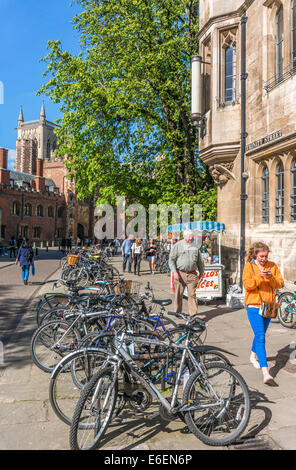 Line of bikes / bicycles on Trinity Street, with part of a university college in the background. City centre, Cambridge, - Stock Photo