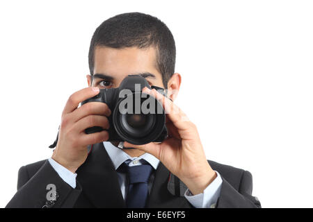 Front view of a professional photographer taking a photograph isolated on a white background - Stock Photo