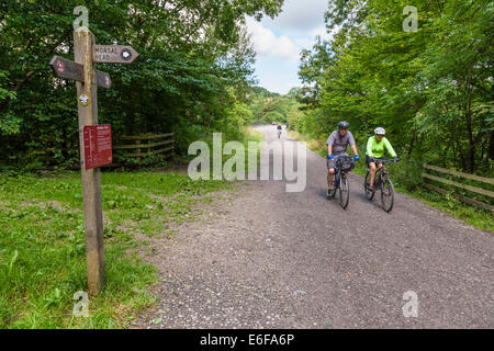 Cycling in the countryside. Cyclists on the Monsal Trail in Derbyshire, Peak District National Park, England, UK - Stock Photo