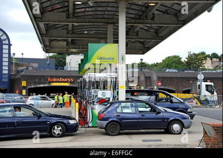 Brighton UK - Drivers filling up with fuel petrol at BP service station - Stock Photo